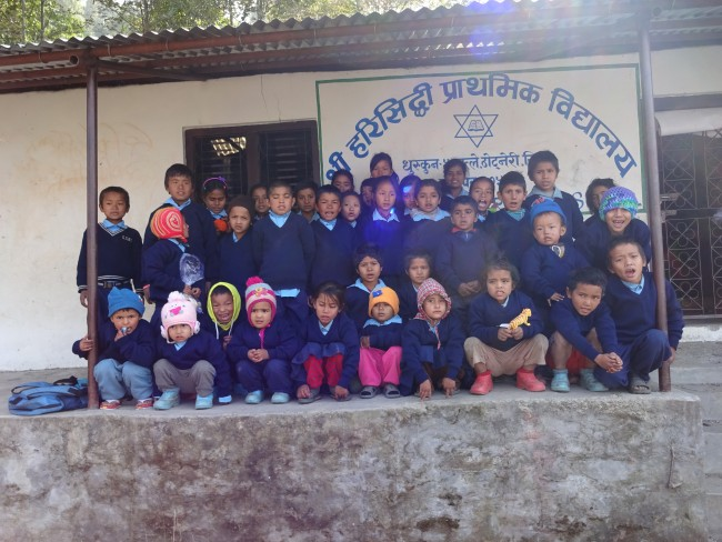Students of Harisiddhi Primary School wearing their new sweaters