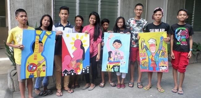 子どもの権利条約の4つの柱である、守られる権利、生きる権利、参加する権利、育つ権利を表す絵を描きました。